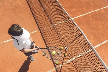 Teenage person ready to play tennis Stockfoto