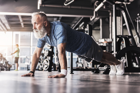 Mature man is enjoying time in sports club