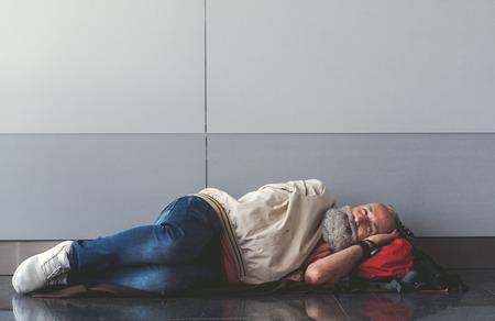 Happy smiling old man lying on floor Stock Photo - 86026662