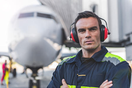 Serene man having job at airdrome