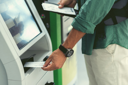 Adult traveler is enjoying modern device