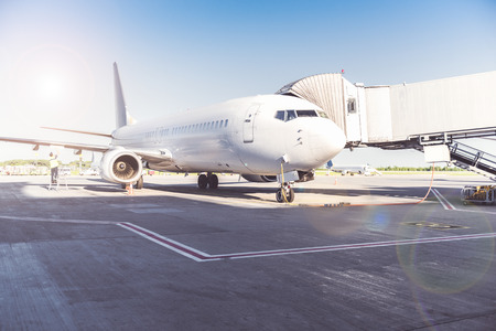 Big aircraft locating at airport. It standing for passenger loading. Copy space Stock Photo