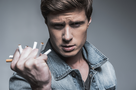 Confident young guy quits smoking Stock Photo