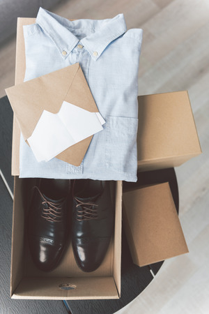 Different boxes with clothes and footwear Фото со стока
