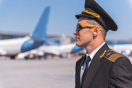 Confident aviator outside of airport Stock Photo