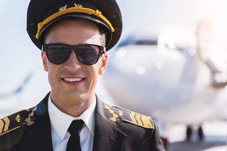 Happy smiling airman glancing ahead
