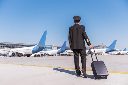 Confident pilot wearing special uniform