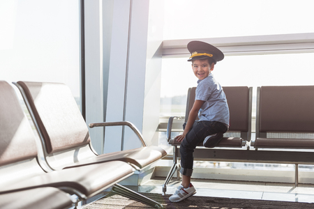 Cheerful smiling little boy in terminal