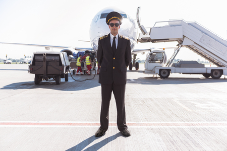 Serious airman locating near plane