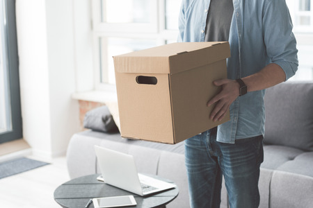 Young male holding cardboard box Stock Photo - 87418072