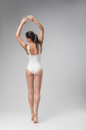 Elegant slim girl posing in underwear Standard-Bild