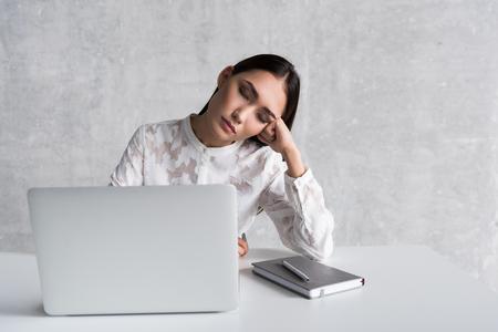 Tired lady sleeping at workplace 版權商用圖片
