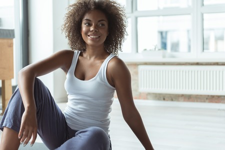 Happy female having break after exercises Stock Photo