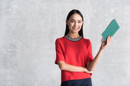 Positive elegant young woman is enjoying her hobby