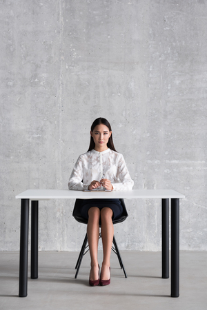 Serious businesswoman undergoing job interview Stock Photo