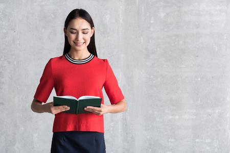Charming woman is enjoying favorite novel Stock Photo