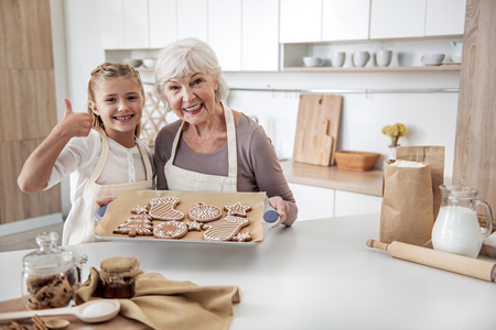 Cheerful family is satisfied with self-made sweets