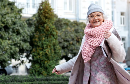 Happy mature woman enjoying walk in town Stock Photo