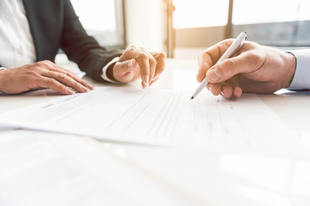Close up man arm putting signature on document. Secretary take it to him. Occupation concept. Copy space Zdjęcie Seryjne - 88404832