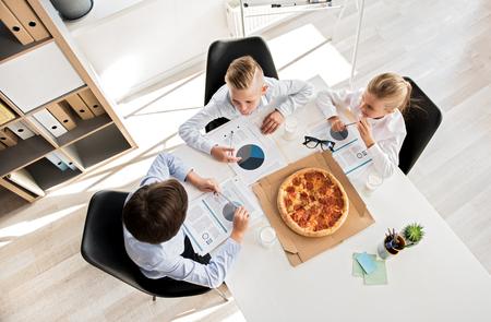 Skillful smart kids are acting as business people Zdjęcie Seryjne