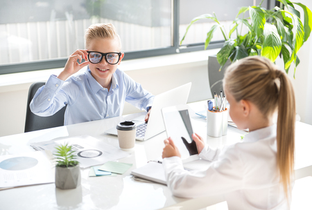 Positive children are working in office