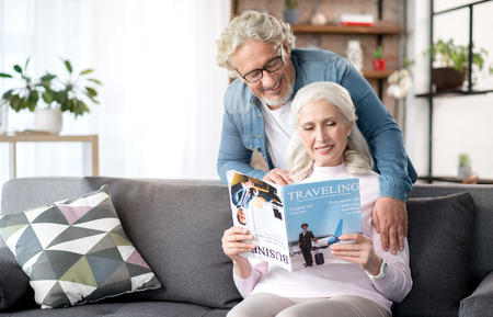 Joyful mature husband and wife entertaining at home together Standard-Bild