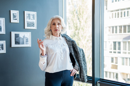 Professional intelligent lady is posing in office Stock fotó
