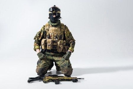 Portrait of calm defender locating near weapon while watching at camera. Profession concept. Copy space Stock Photo