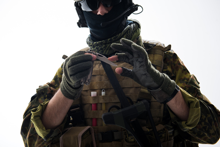 Close up soldier hands keeping collapsible knife. He looking at it. Profession concept Stock fotó - 92581637