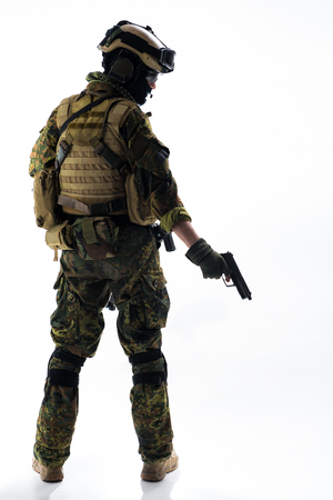 Full length back view confident soldier shooting with pistol. Army concept Stock Photo