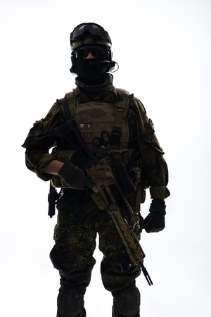 Portrait of orderly soldier serving with assault rifle. Military concept. Isolated Stock Photo