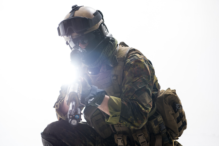 Portrait of soldier looking at sniper scope of weapon. War concept. Isolated Stock Photo