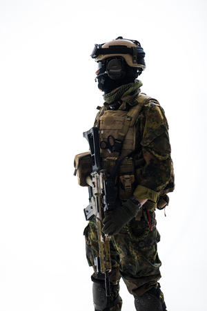 Side view serious soldier telling by microphone while holding modern weapon in hands. Army concept. Isolated Stock Photo