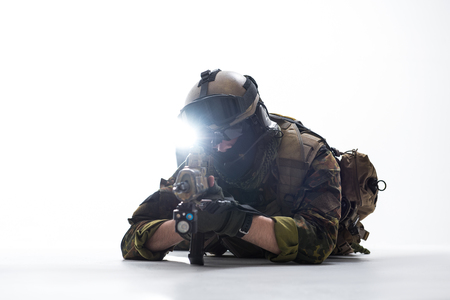 Portrait of orderly soldier watching at assault rifle. War and protection concept Stock Photo