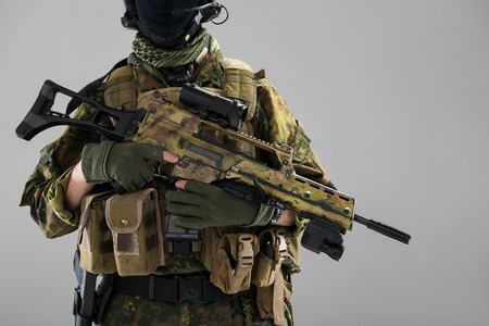 Close up male hands keeping assault carbine. Danger and military concept. Isolated