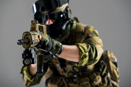 Close up male hands keeping assault carbine. Profession and army concept. Isolated Stock Photo