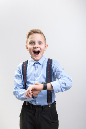 This is exactly what I wanted. Waist up portrait of cheerful kid enjoying new gadget. Isolated on background