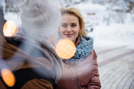 You are my love. Affectionate loving couple in dating in winter park. They are looking at each other with fondness Stock Photo