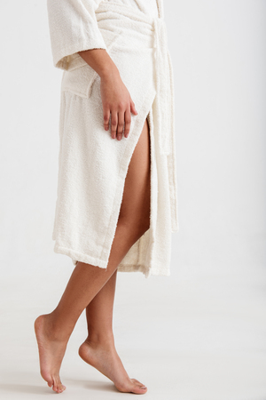 Close up of female legs with soft skin visible from under the robe Stok Fotoğraf