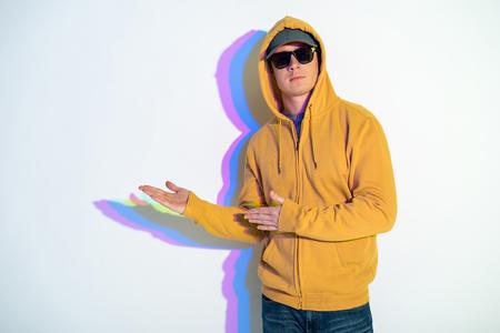 Portrait of calm cool man showing hands aside.. Direction concept