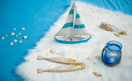 Top view composition of miniature barque on fluffy rug. Maritime concept Stock Photo