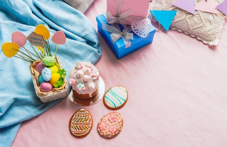 Top view delicious cakes and colored eggs situating near gifts. Bakery concept Stock Photo