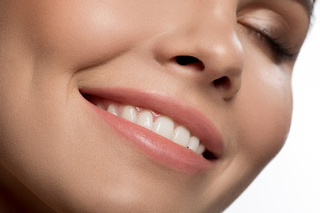 Close up of happy female smile with perfect white teeth Stock fotó