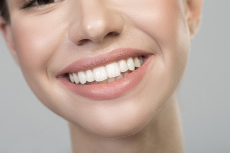 Close up of happy smile of optimistic cute girl with straight white healthy teeth. Oral care concept Stock Photo