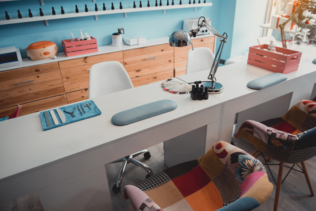 Different equipment for creating beautiful manicure and manicure utensils locating on desk. Design of beauty salon concept