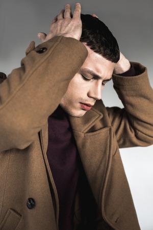 Side view confused male feeling headache. He closing eyes. Trouble concept Reklamní fotografie