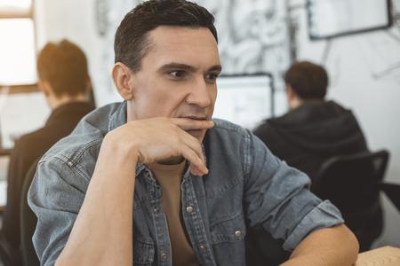 Portrait of pensive employer having job in office. Reverie concept