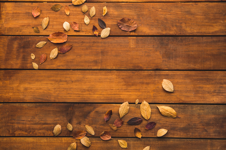 Top view close up of autumnal leaves locating on wooden surface. Season concept Stock Photo