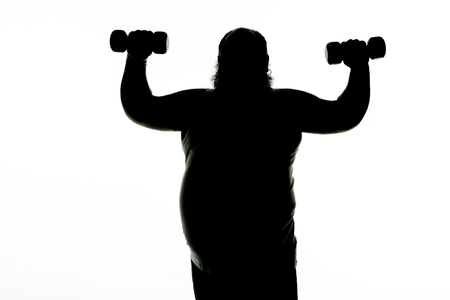 Male fatty with belly is going for sports. He is standing and lifting dumbbells. Beginning healthy lifestyle concept. Isolated