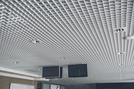 New digital devices locating on silver ceiling in contemporary business center